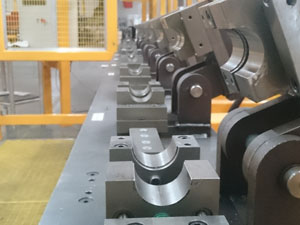Hydraulic powered CNC tube forming system for forming annular rings in aluminium alloy tube